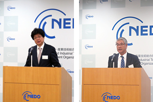 Executive Directors Kuniyoshi and Ueda each at the podium