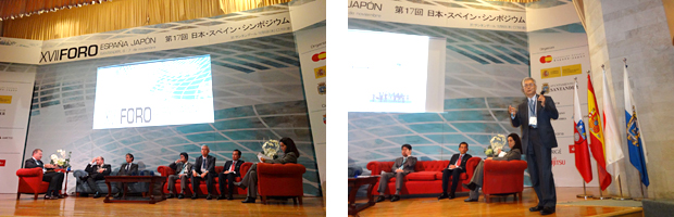 Panelists on the platform and Furukawa speaking to the audience