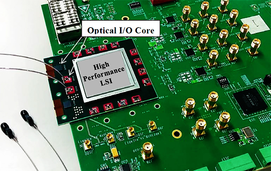 Photo: Circuit board implementation of chip-scale optical transceivers (optical I/O cores) installed around a high-performance LSI.