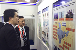 photo: Japan's State Minister of Economy, Trade, and Industry Yosuke Takagi visiting the NEDO booth (right)