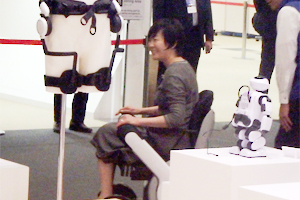 photo: Mrs. Akie Abe, spouse of the Prime Minister of Japan, test-riding an electric wheelchair