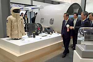 photo: Chief Cabinet Secretary Yoshihide Suga visiting