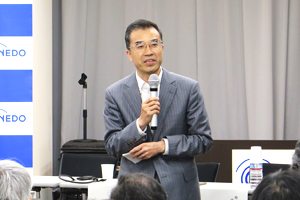 photo: Executive Director Yoshiteru Sato giving his speech