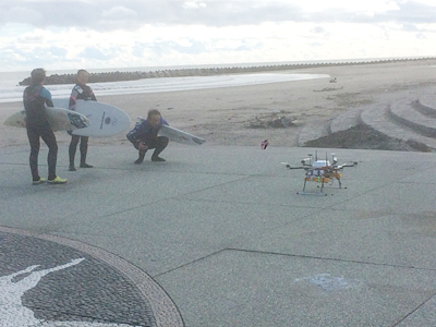 photo of surfers and the drone