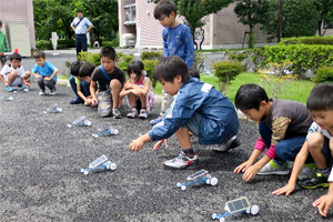 Children testing the cars they built