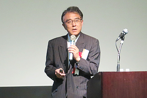 Head of Cybersecurity Integration at Nippon Telegraph and Telephone Corporation Shinichi Yokohama giving his speech giving his speech at the symposium