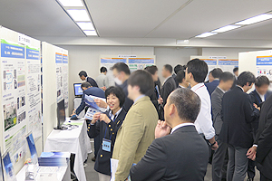The participants having a discussion at the poster session