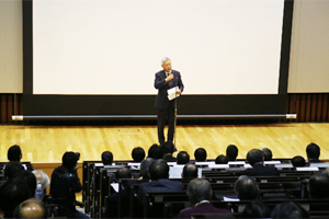 NEDO Chairman Kazuo Furukawa speaking at the symposium