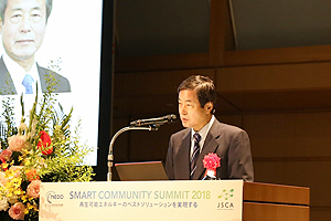 NEDO Chairman Hiroaki Ishizuka giving the opening speech