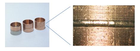今回開発した青色半導体レーザー光源により溶接を行った純銅のサンプル 左:純銅パイプ(φ10mm、厚み0.5mm)の突合せ溶接サンプル(左端は銅とSUSの異種接合) 右:溶接ビード部拡大