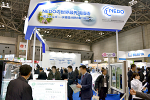 Photo of lively NEDO exhibit area with visitors