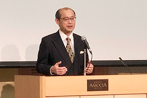 Photo of NEDO Executive Director Masayoshi Watanabe delivering opening remarks