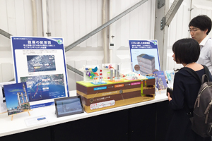 Photo of model and video displays related to carbon capture and storage demonstration project carried out by Japan CCS Co., Ltd. in city of Tomakomai, Hokkaido Prefecture
